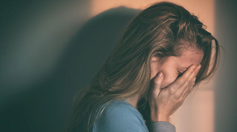 depressed woman abuse victim